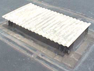 Fiberglass skylight panel on roof curb